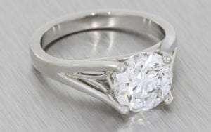 A unique platinum round brilliant cut engagement ring
