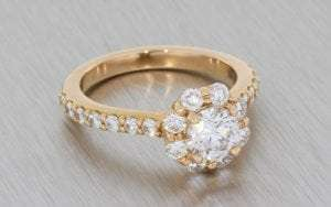 Rose Gold Vinatage floral inspired engagment ring featuring a round brilliant diamond