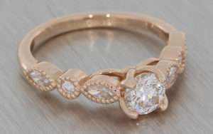Rose gold with fancy shape diamond and moissanite ring